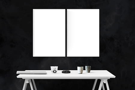 two white boards and white wooden table