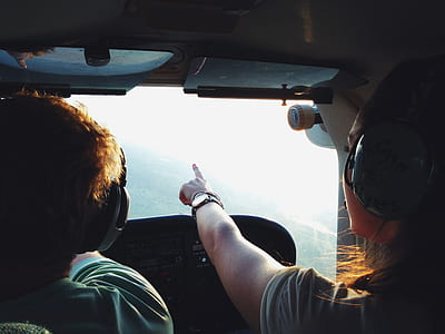 Persons on Aircraft Pointing on View during Daytime