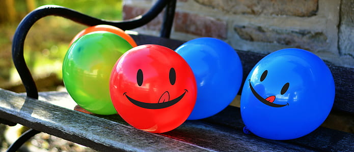 assorted balloons on patio bench
