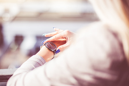 Woman Checking The Time on Her Fashion Watches