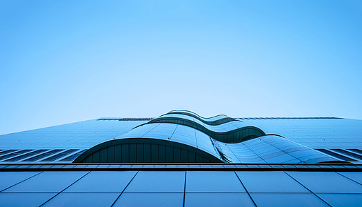 low angle architectural photography of glass building