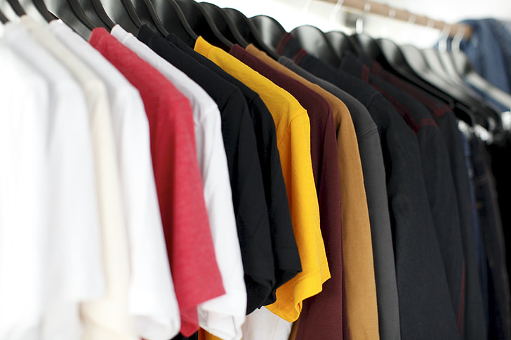 closeup photo of clothes hanging on hanger