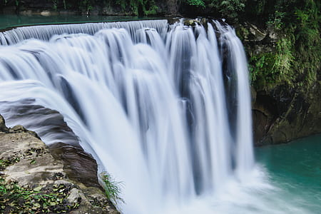 timelapse photography of flowing multi-tier waterfalls