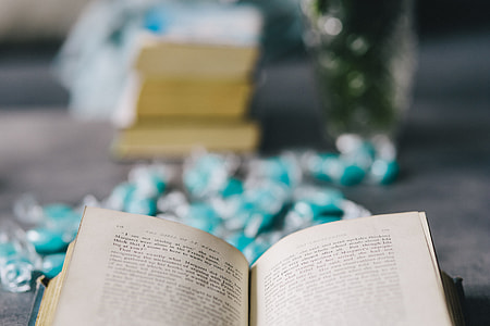 Book and blue candy