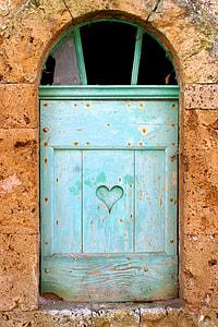 green wooden window facade