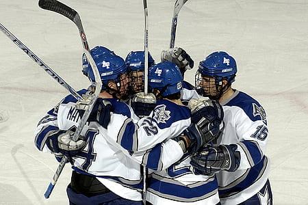 five ice hockey players at ice hockey arena