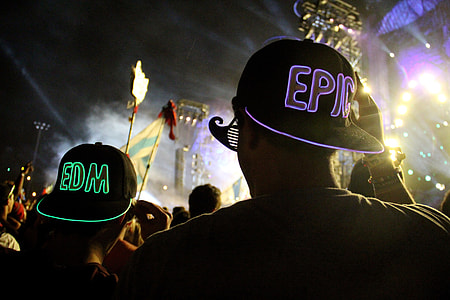 People in the crowd at an electronic music festival