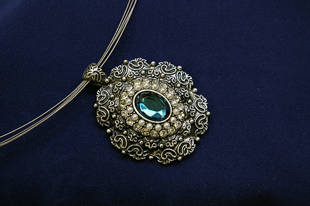oval silver-colored green gemstone pendant necklace