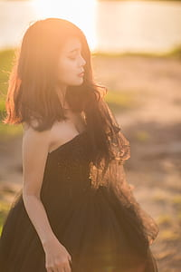 shallow focus photography of woman in black strapless dress