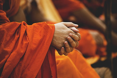 monk holding his hands
