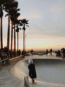 child walking toward skate ramp