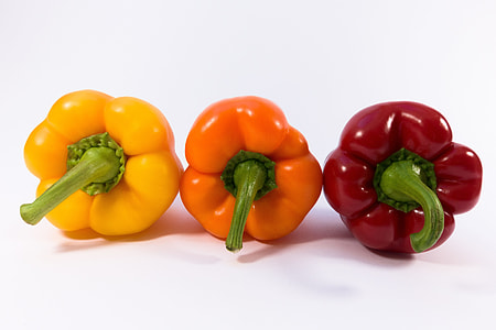 three assorted-color of bell peppers with white background