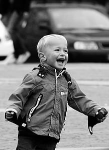 grayscale photo of toddler in jacket