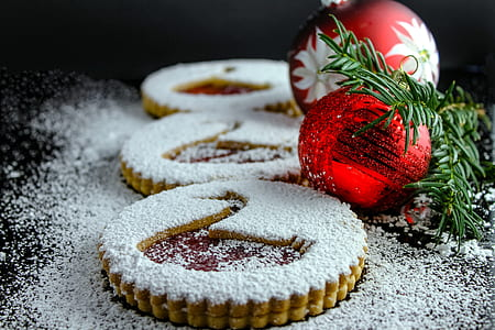 two red baubles beside three cookies