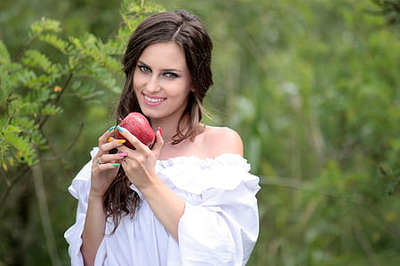 woman holding red apple fruit