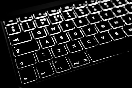 Close-up shot of the backlit keyboard from a laptop computer