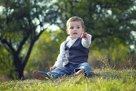 boy wearing white and blue dress shirt