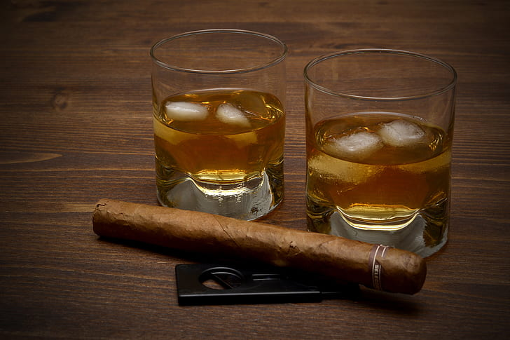 brown tobacco beside clear drinking glasses