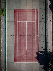 aerial view of red and grey concrete court