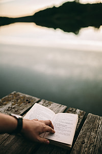 Reading book at lake