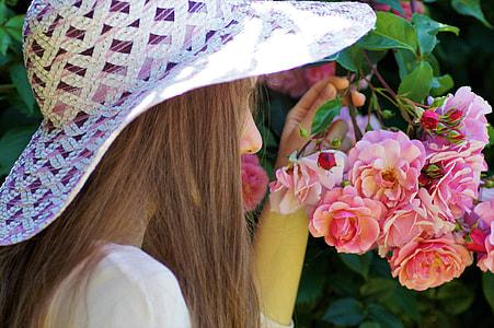 photo of woman wearing white sun hat
