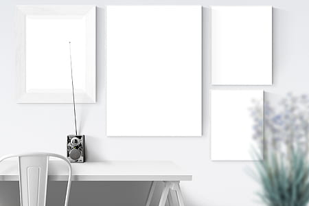 white wooden boards with black radio on table