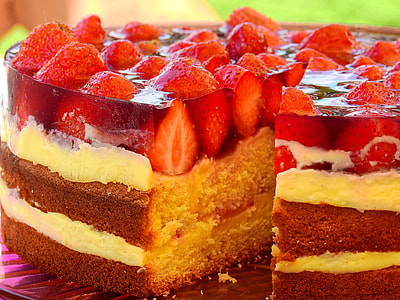 brown and white cake with strawberry toppings