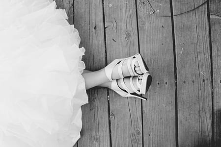 grayscale photo of pair of open-toe stilettos