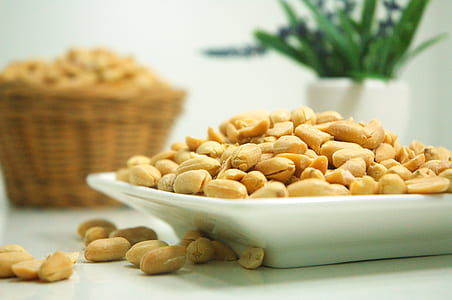 brown peanuts on top of white ceramic frame