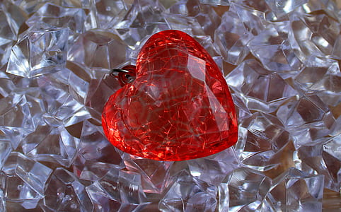 closeup photo of red heart pendant