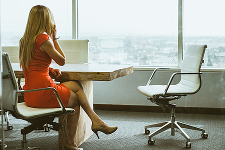 Business woman in office by windows