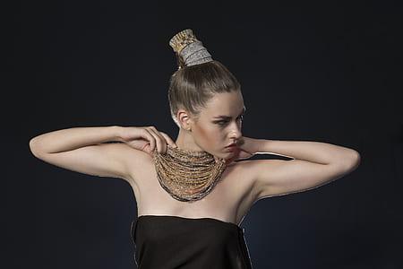 woman in black strapless dress