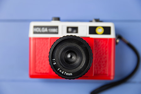 Overhead shot of a red retro camera