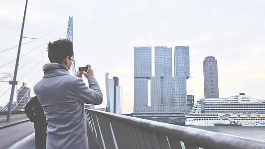 Rear View of Man Photographing Cityscape