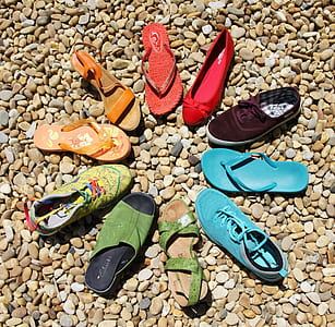 assorted-color of sandal lot in brown rocks