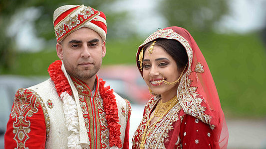 woman in red and white wedding sari dress