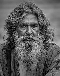 grayscale photo of man wearing robe