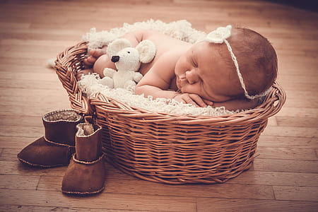 baby laying on wicker basket