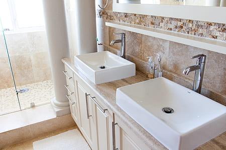 two white ceramic sinks