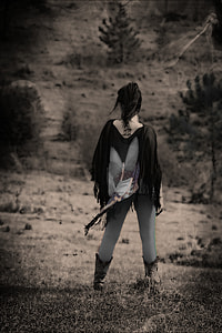 black and white photo of person on costume playe