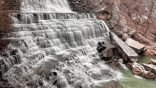 Waterfalls Flowing on Brown Rock Formation Towards River