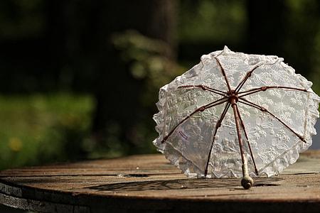 white floral umbrella on table