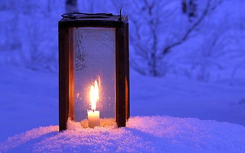 candle lantern on snow