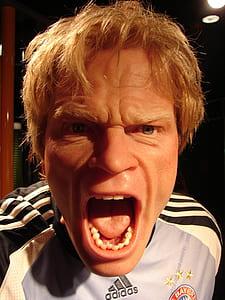 closeup photo of man wearing Adidas top open mouth