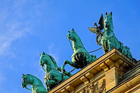 four blue horses statues