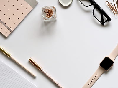 flat lay photography of Apple Watch near eyeglasses