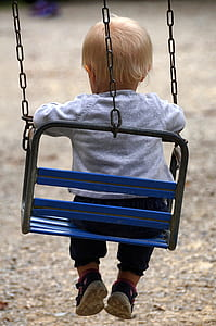 baby sitting on swing chair