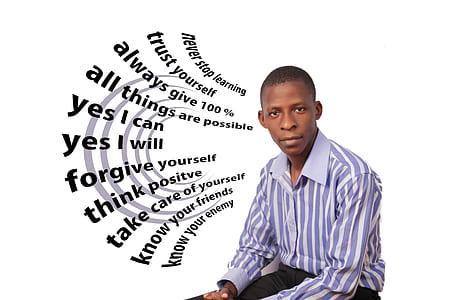 photo of man sitting on white surface
