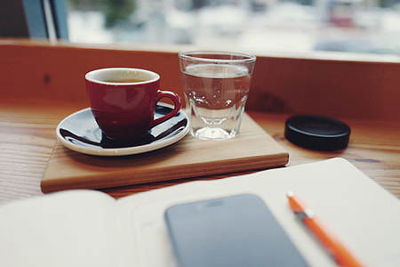 Coffee cup and glass of water