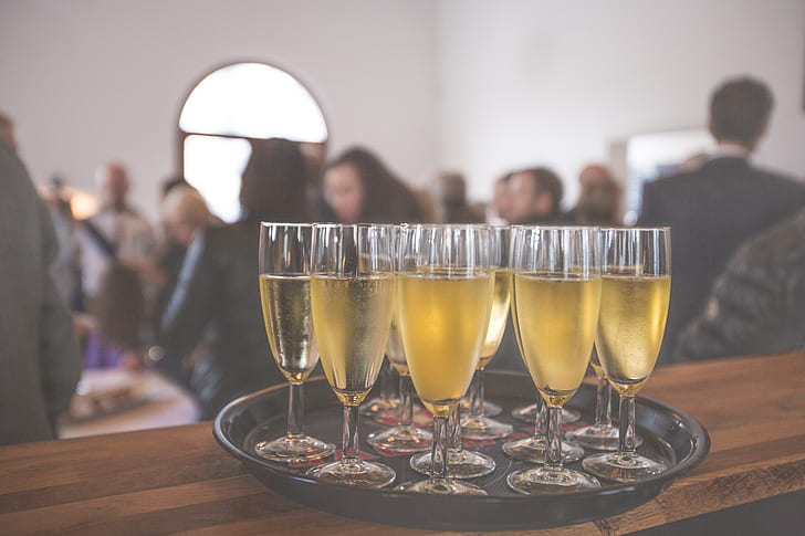 clear champagne flutes on tray